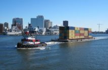 A tug moving containers on a barge. SUNY photo.