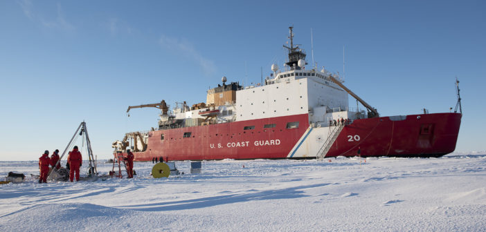 Scientists and engineers deploy an ice tethered profiler on the Arctic ice Sept. 30, 2018, about 350 miles northeast of Barrow, Alaska, from the Coast Guard icebreaker Healy. NyxoLyno Cangemi/Coast Guard photo.
