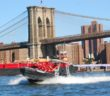 New York Media Boat's 9-meter Ribcraft carries a tour group past the Brooklyn Bridge. Kirk Moore photo.