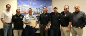 The Coast Guard presented its first New York COIs to Weeks Marine Sept. 5 in Cranford, N.J. From left to right: Patrick Whelan, executive vice president and general counsel; Ronnie Clifford, towing compliance officer; Coast Guard Cmdr. Jacob Hobson; Shaun O'Brian, towing senior port engineer; Jason Marchioni, vice president of marine services; Capt. Benjamin Peterson, towing manager; and Eric Ellefsen, president.