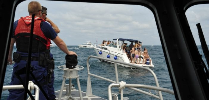 Boarding officers from Coast Guard Station Calumet Harbor prepare to approach a boat operator on Lake Michigan to ensure there are enough life jackets onboard for each passenger, August 18, 2018. Coast Guard photo/ Master CPO Alan Haraf.