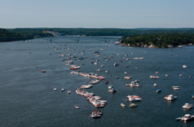 Recreational boats rafted up on the Lake of the Ozarks. One of the busiest boating areas in the Midwest, the Lake of the Ozarks has been a target in the Coast Guard's ongoing crackdown on illegal charter operations. Corps of Engineers photo.