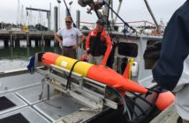 Onboard a research vessel, the oil scanning robot LRAUV is ready to test its new configuration. Coast Guard photo.
