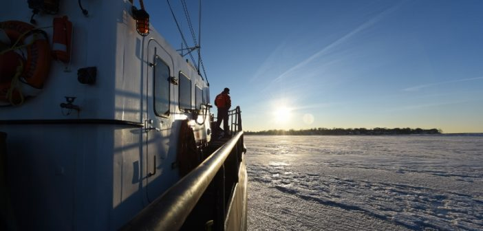 The crew of Coast Guard cutter Shackle, a 65' small harbor tug, breaks ice Jan. 10, 2018, near Logan International Airport in Boston Harbor. Coast Guard photo/PO3 Andrew Barresi.