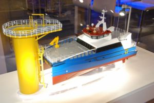 A model of a Damen wind energy transfer vessel and turbine base was on display at the International WorkBoat Show. Kirk Moore photo.