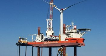 Deepwater Wind used the Norwegian construction vessel Brave Tern along with U.S. liftboats from Montco Offshore (at left) to build the Block Island Wind Farm off Rhode Island in 2016. Deepwater Wind photo.