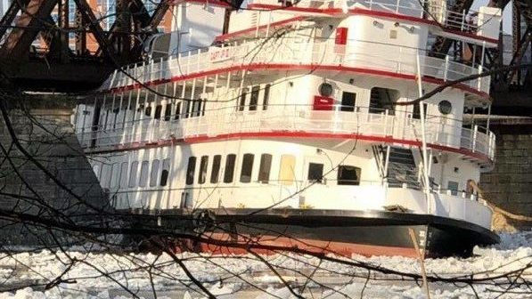 The Hudson River cruise boat Capt JP III was stranded under a railroad bridge at Albany, N.Y., after being swept downriver in ice floes. NY State Police photo.