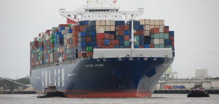 The containership CMA CGM John Adams inbound to Savannah, Ga., with the tugs Cooper Moran (left) and Laura K Moran. Kirk Moore photo.