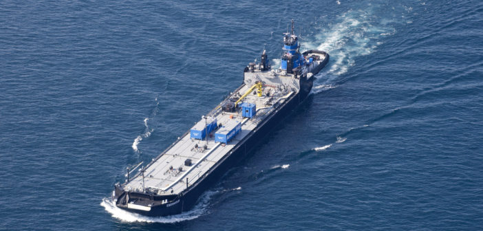 Aerial photo of the barge Endeavour and the tug Karen Andrie on Lake Michigan. Auxo Investment Partners photo