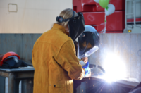 A silver dollar and owners' initial were welded into the keel of a new Foss Maritime Tug. Foss Maritime photo.