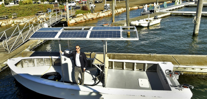 Michael Pascucilla, director of health for the East Shore District Health Department, on the world's first full-size, fully electric, zero carbon emissions, solar-powered pump-out vessel. Torqeedo photo