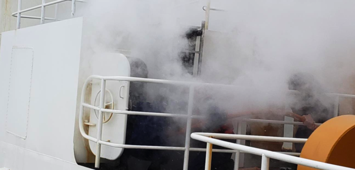 Smoke billows from a hatch on the icebreaker Polar Star as the crew fights a Feb. 10 fire on the ship. Coast Guard photo.