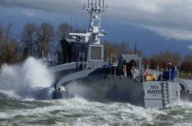 The Navy autonomous test vessel Sea Hunter undergoing sea trials in the Willamette River at Portland, Ore., in 2016. DARPA photo.