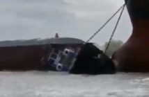 The Michelle Ann sinking after striking the anchor chain of a bulk carrier near Baton Rouge, La., on March 14, 2019. YouTube image by seagoat1970
