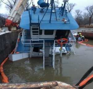 The towboat Ms Nancy C was raised five days after sinking on Everett Lakes near mile marker 832 on the Mississippi River. NTSB photo
