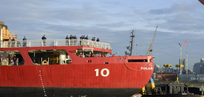 The crew aboard the Coast Guard cutter Polar Star, a 399-foot heavy icebreaker pull into Coast Guard Base Seattle, March 11, 2019. The crew was underway for 107 days in support of Operation Deep Freeze, a U.S. military resupply operation for the U.S. Antarctic Program. U.S. Coast Guard photo by Petty Officer 3rd Class Amanda Norcross.