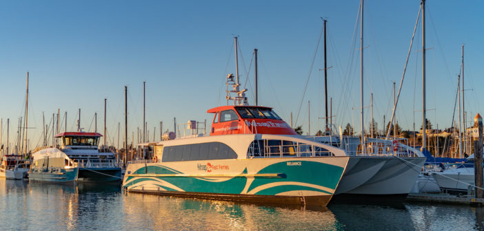 The hybrid-electric water taxi (rear) and ultra low-wake vessel built for Kitsap Transit. All American Marine photo