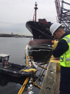 Capt. Jason Tama, commander Sector New York and the Captain of the Port of New York and New Jersey, assesses the clean up operations of an oil spill in the Arthur Kill waterway in Staten Island, March 29, 2019. Coast Guard photo/Cmdr. Nicholette Vaughan