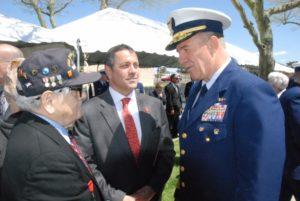 Commandant Adm. Karl Schultz talks with D-Day veteran Frank DeVita, left, and son Richard DeVita at the dedication of the Coast Guard Enlisted Memorial. Kirk Moore photo
