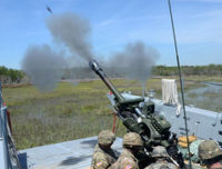 Virginia National Guard soldiers conduct waterborne artillery live fire exercises during Operation GATOR April 24-25, 2019, at Camp Lejeune, North Carolina. National Guard photo/Mike Vrabel