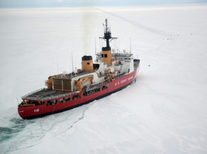 The Coast Guard Cutter Polar Star cuts through Antarctic ice in the Ross Sea near a large group of seals as the ship's crew creates a navigation channel for supply ships, Jan. 16, 2017. The resupply channel is an essential part of the yearly delivery of essential supplies to the National Science Foundation's McMurdo Station. U.S. Coast Guard photo by Chief Petty Officer David Mosley.