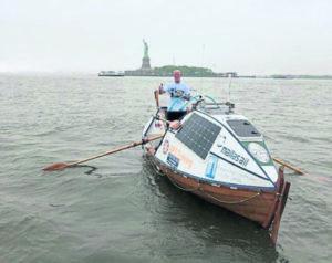Duncan Hutchinson on his rowboat Sleipner in New York Harbor at the start of his 2018 trans-Atlantic crossing attempt. Duncan Hutchinson via Facebook.