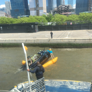 NY Waterway deckhand Edwin Montoya prepares to pick up the helicopter pilot. NY Waterway photo