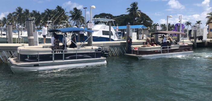 Two pontoon boats moored to a pier at Haulover Inlet, Florida, Mar. 31, 2019. The Coast Guard boarded the two boats and terminated both voyages as illegal charters. Coast Guard Photo