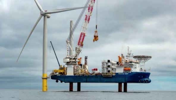 The wind turbine installation vessel Vole au Vent installs the first wind turbine in U.S. federal lease waters, as part of the Coastal Virginia Offshore Wind project, June 20, 2020. Dominion Energy photo.
