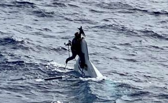 Containership crew rescued Florida man clinging to boat 86 miles offshore